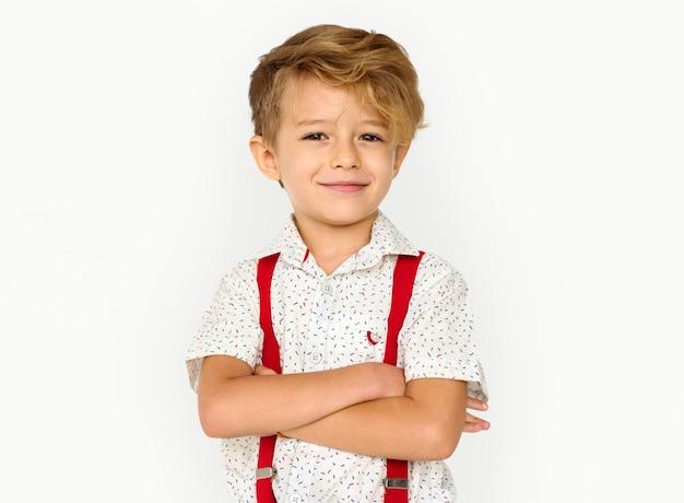 Mały chłopiec uśmiecha się szczęście studio portret