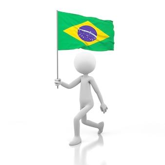 Mały człowiek chodzący z flagą brazylii w dłoni. obraz renderowania 3d