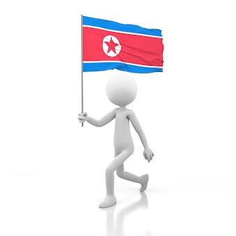 Mały człowiek chodzący z flagą korei północnej w dłoni. obraz renderowania 3d
