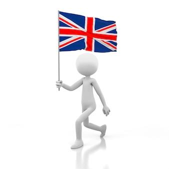 Mały człowiek chodzący z flagą wielkiej brytanii w dłoni. obraz renderowania 3d
