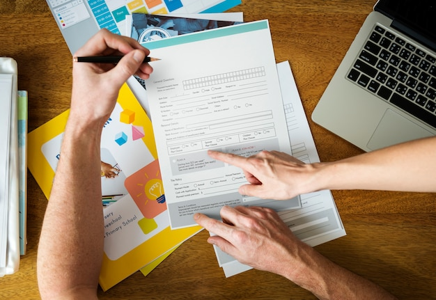 Man filling applicatio form documents information