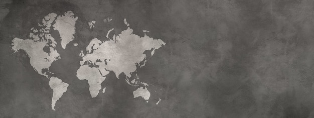 Mapa świata na białym tle na czarnej powierzchni ściany betonowej