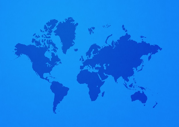 Mapa świata na białym tle na niebieskiej powierzchni
