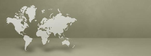 Mapa świata na białym tle na szarej ścianie