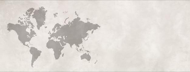 Mapa świata na białym tle na tle białej ściany betonowej. poziomy baner