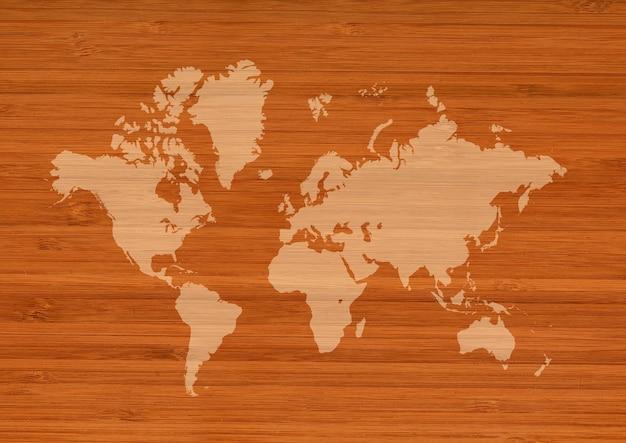 Mapa świata na białym tle na tle brązowej ściany drewniane