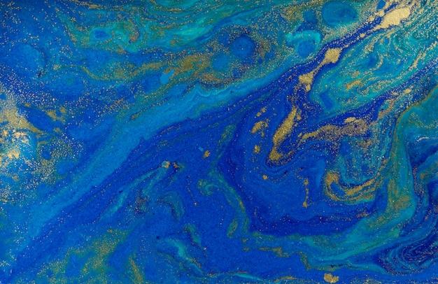 Marmurkowaty błękitny i złocisty abstrakcjonistyczny tło