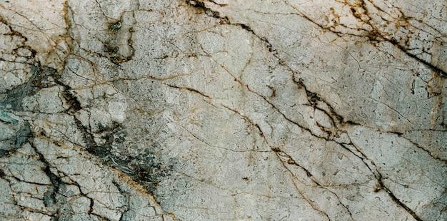 Marmurowa szara tekstura w kolorze pantone 2021 jako tło.