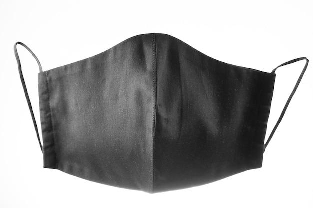 Maska ochronna na twarz na białym tle. czarna maska na twarz wielokrotnego użytku. maska antywirusowa