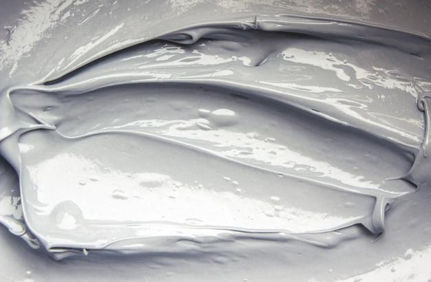 Maska z gliny błotnej z minerałami z morza martwego. tekstura. selektywna ostrość.