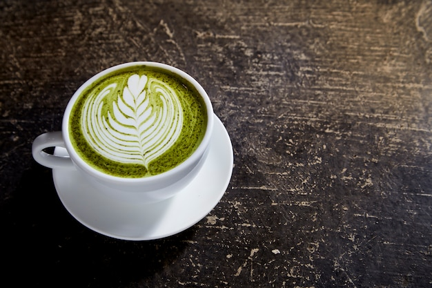 Matcha tea latte on black table