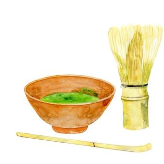 Matcha w filiżance z łyżeczką i bambusową trzepaczką