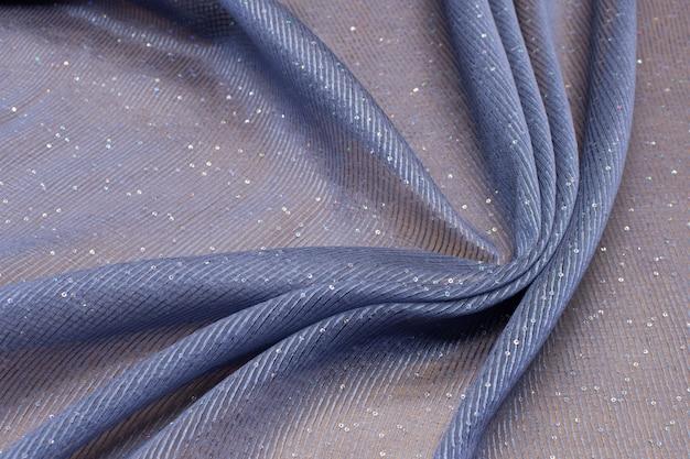 Materiał w cekiny i lurex czarny w artystycznym układzie. tekstura,