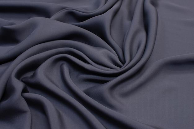 Matowa tkanina jedwabna. kolor jest szary. tekstura, tło, rysunek, wzór.