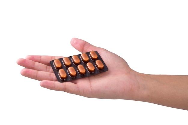 Medycyna w ręce kobiety na białym tle
