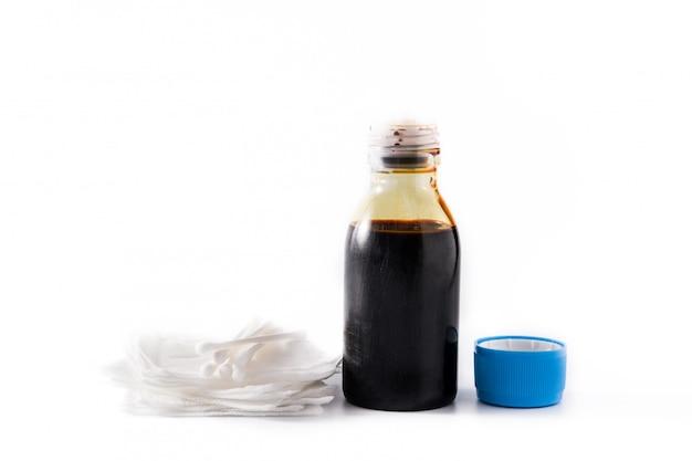 Medyczny jod w butelce i gazach odizolowywających na bielu
