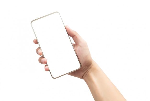 Męska ręka trzyma złocistego smartphone z pustym ekranem odizolowywającym
