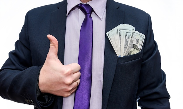 Męskie dłonie z banknotów dolara w kieszeni