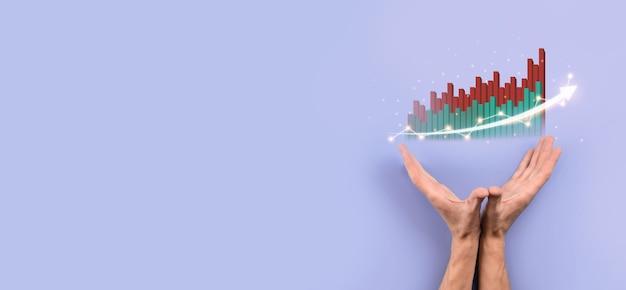 Męskiej ręki trzymającej ikonę wykresu. sprawdzanie analizowania wykresu wykresu wzrostu danych sprzedaży i giełdy w globalnej sieci. strategia biznesowa, planowanie i marketing cyfrowy.