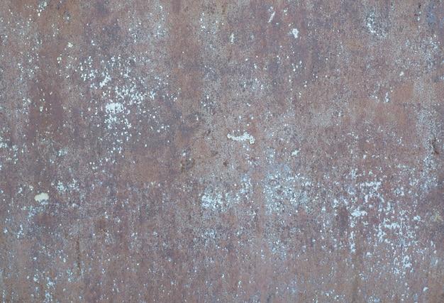 Metaliczne tło grunge. zardzewiały czerwony mur tekstura tło.