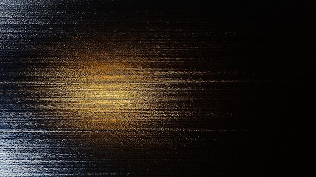 Metaliczne tło tekstury ze złotym efektem świetlnym