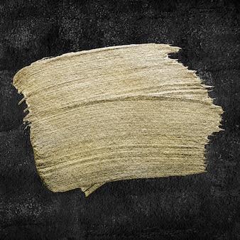 Metaliczne złoto tekstury obrysu pędzla farby olejnej na czarno
