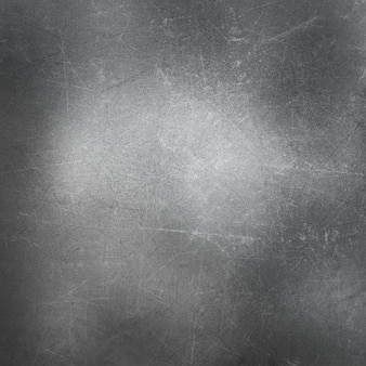 Metaliczny tła z zadrapania i plamy
