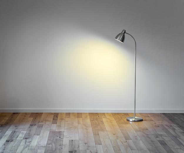 Metalowa podłogowa lampa w pustym pokoju z cieniem na biel ścianie, kopii przestrzeń dla teksta