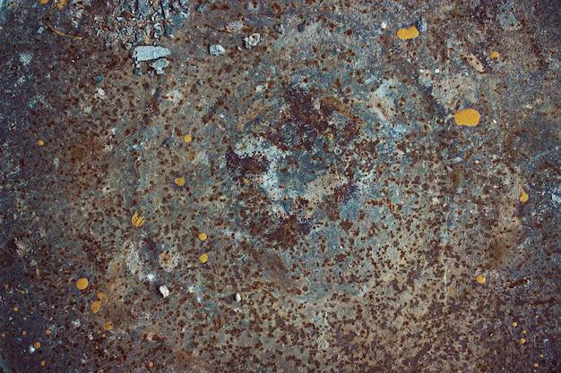Metalowa tekstura. ciemne zużyte zardzewiały metal tekstura tło. tekstura zardzewiały metal z plamami. abstrakcyjne tło.