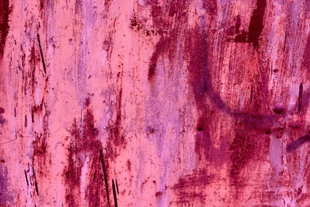 Metalowa tekstura z zadrapaniami i pęknięciami, które mogą być użyte jako tło