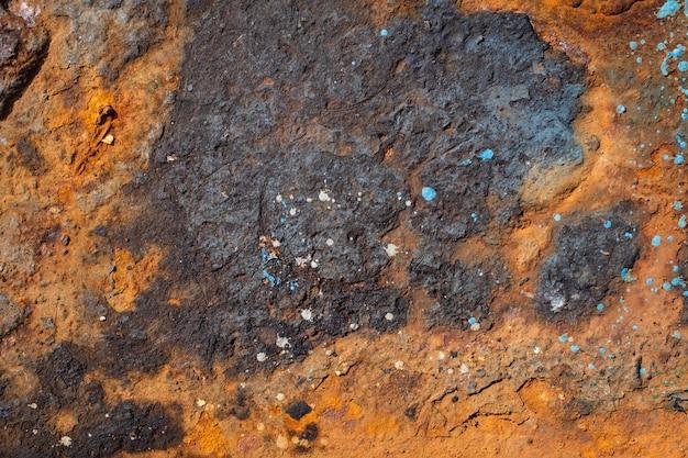 Metalowa tekstura ze ścianą rdzy zarysowania i pęknięcia