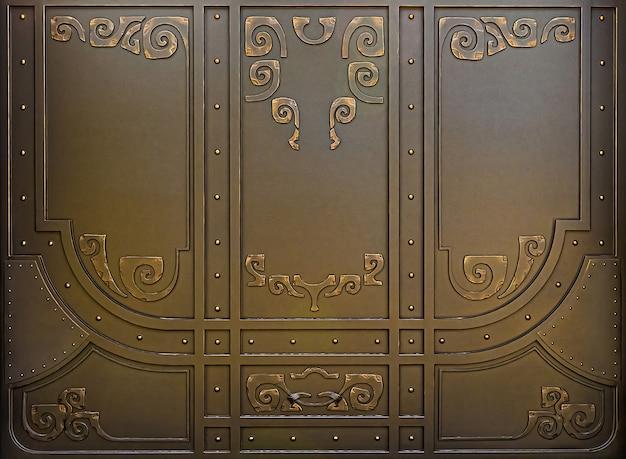 Metalowe rzeźbione tło bramy z nitami i elementami spiralnymi.