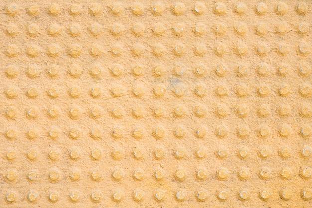 Metalowe wzorzyste żółte tło