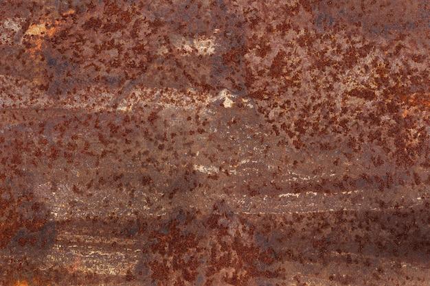 Metalu tekstury ośniedziały tło, stara żelazo rama z porysowanym i pękającym.