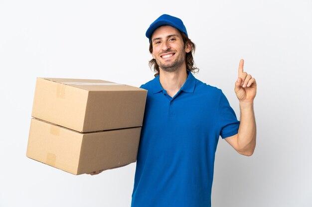 Mężczyzna dostawy na białym tle na biały pokazując i podnosząc palec na znak najlepszych