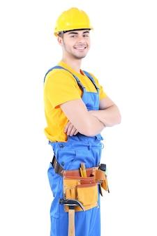 Mężczyzna konstruktora w żółtym kasku na białym tle