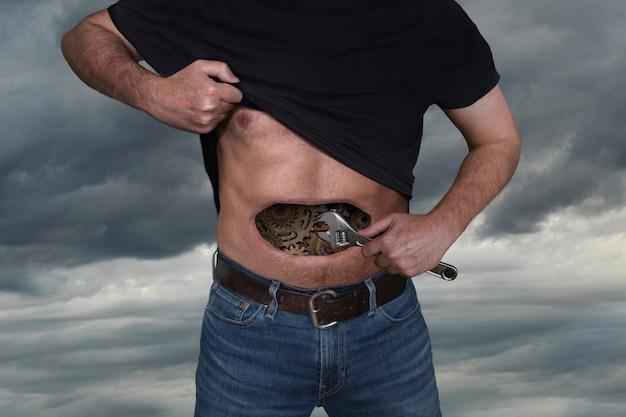 Mężczyzna naprawia koła zębate w żołądku