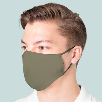Mężczyzna noszący maskę z zielonej tkaniny w ramach kampanii ochrony covid-19