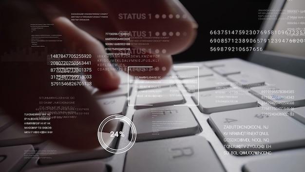 Mężczyzna pracujący na klawiaturze laptopa z graficznym hologramem gui interfejsu użytkownika