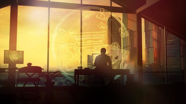 Mężczyzna pracuje w domu przy komputerze.