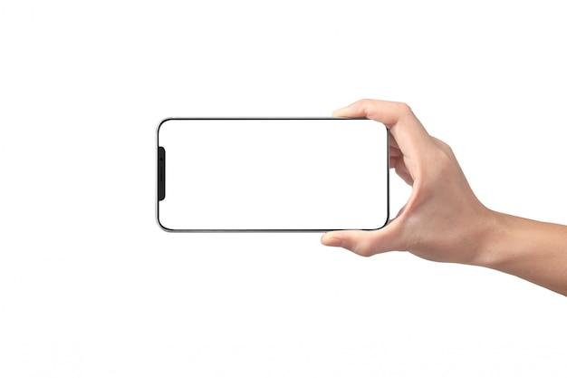 Mężczyzna ręki trzymającej urządzenia smartphone i dotykając ekranu