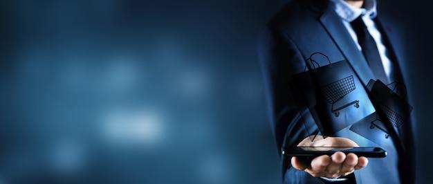 Mężczyzna robi zakupy online przez telefon na niebiesko