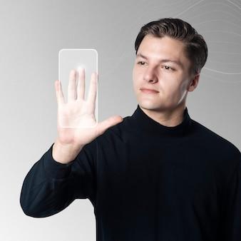 Mężczyzna skanuje dłoń na ekranie wirtualnego interfejsu