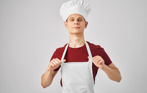 Mężczyzna szefa kuchni fartuch gotowania kuchnia restauracja styl życia