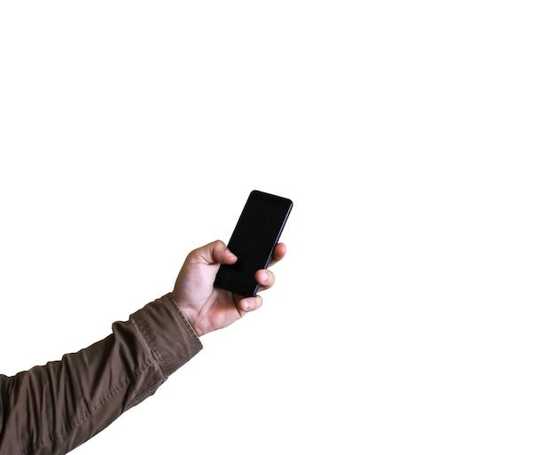 Mężczyzna trzyma w rękach smartphone. na białym tle. uzależniony od technologii.