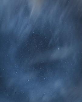 Mgliste gwiaździste nocne niebo w tle