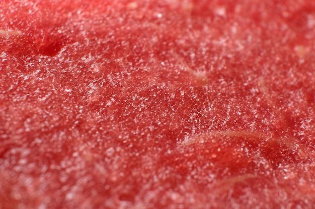 Miąższ czerwonego dojrzałego soczystego arbuza makro