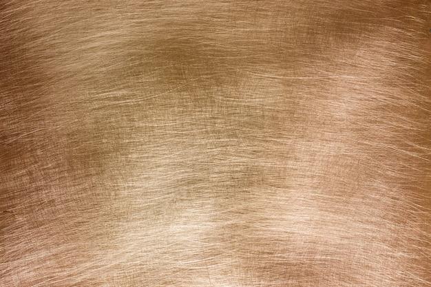Miedziane tło szczotkowane, tekstura starego metalu z bliska