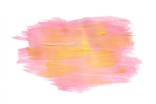 Miejsce rozmazanej farby akrylowej w kolorze różowego i żółtego złota. na białym tle