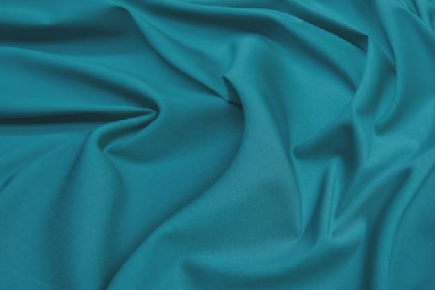 Miękka tkanina jedwabna lub tekstura tkaniny satynowej. pomarszczony wzór tkaniny.